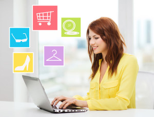fashion, sale, people and technology concept - smiling woman with laptop computer shopping online ant home