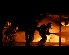 US Marine Corps (USMC) Fire Fighters assigned to Aircraft Rescue and Fire-Fighting (ARFF), train to extinguish fires inside the mock aircraft fire pit, aboard Marine Corps Air Station Beaufort, South Carolina (SC). (USMC PHOTO BY LCPL EDWARD BROWN 050217-M-2697B-020)