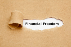 Financial Freedom Torn Paper