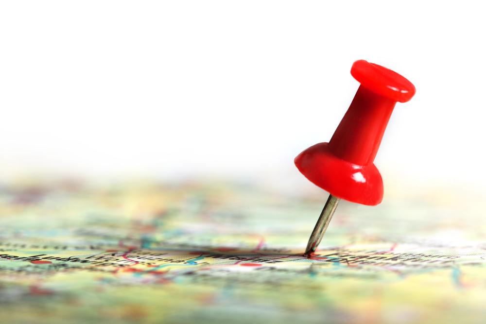 thumbtack on map