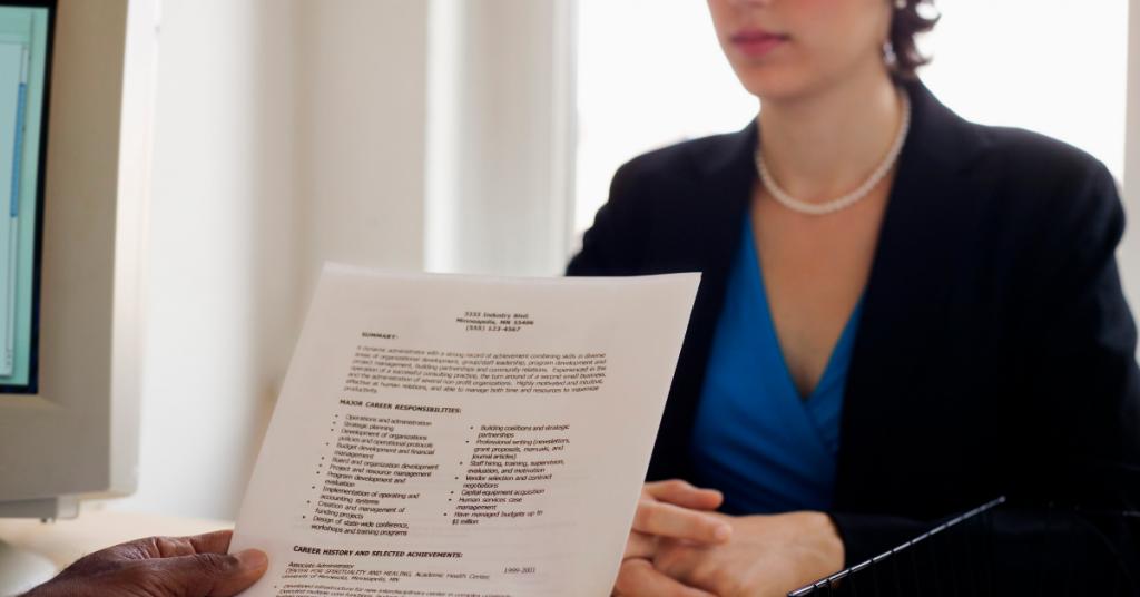 reading resume at job interview